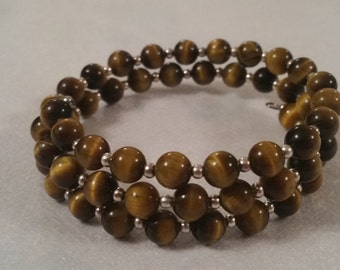 Tigers Eye and silver bead bracelet formed on memory wire.