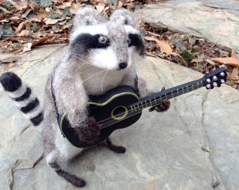 Rocky Raccoon strums a little tune for you....
