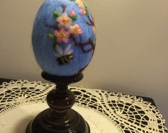Needle felted Easter eggs with flowers and branches of tree