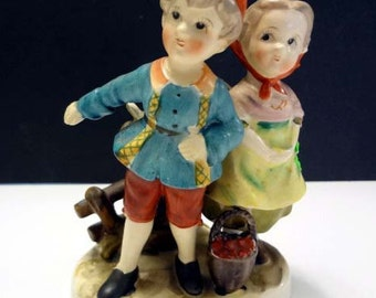 Boy and girl figurine