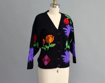 vintage cropped 1980s cardigan . black cardigan . womens small medium cardigan . pixelated flower pattern and front pockets