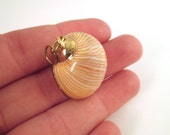 One gold dipped striped seashell pendant with loop