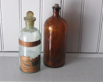 2 Antique Bottles with Stoppers Clorox and Butter of Antimony