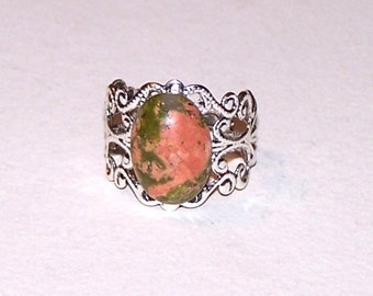 silvery filigree ring with green and orange stone