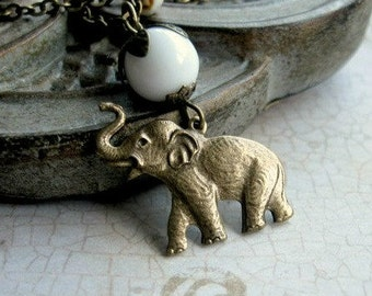 Elephant necklace, brass charm, white glass beads, brass chain, wildlife animal