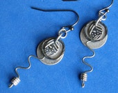 Dangle silver metalwork earrings Oxidized matte finish Soldered ring Round disk Four layers of defined design