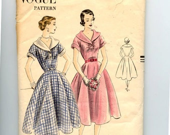 1950s Vogue 7353 Dress Pattern 7353 Fit & Flare Dress has Portrait Neckline, Shawl Collar, Circle Skirt, Short Cuffed Kimono Sleeves Bust 30