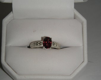 Genuine Red Zircon in Sterling Silver Diamond cut ring Size 6.5