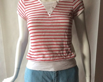 Early 1980's striped knit top, cap sleeve, with vee neck, mesh inserts, and eyelets, small / medium