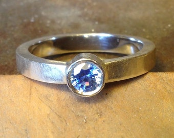 Handmade recycled silver & high quality ethical sapphire solitaire ring.