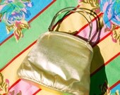 Vintage Gold clutch/purse/bag with gold straps and silk gold lining  LABEL: Ande