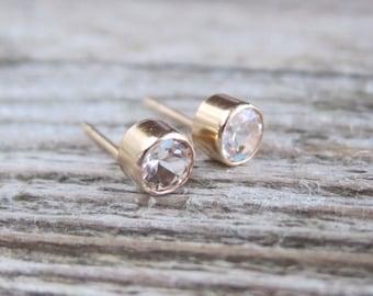 Gold gemstone stud earrings. White topaz, peridot, amethyst, garnet, citrine, aquamarine. 4 mm studs.