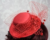 Made to order hand crafted mini Boater made with old fashion millinery techniques in Red Silk
