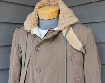 vintage 40's - 50's  B-9 style US Military flight jacket. Cotton shell w/ sheepskin hood. Extremely warm. Size 40 - 42