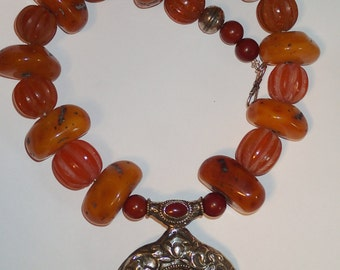 Large Amber Beaded Necklace with Tibetian Silver Pendant