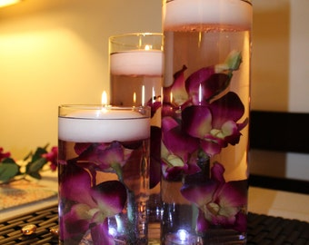 purple with yellow center dendrobium orchid floating candle centerpiece