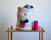 hand knitted storage bin made of lambswool with colorful embroidery, woven lining in gray