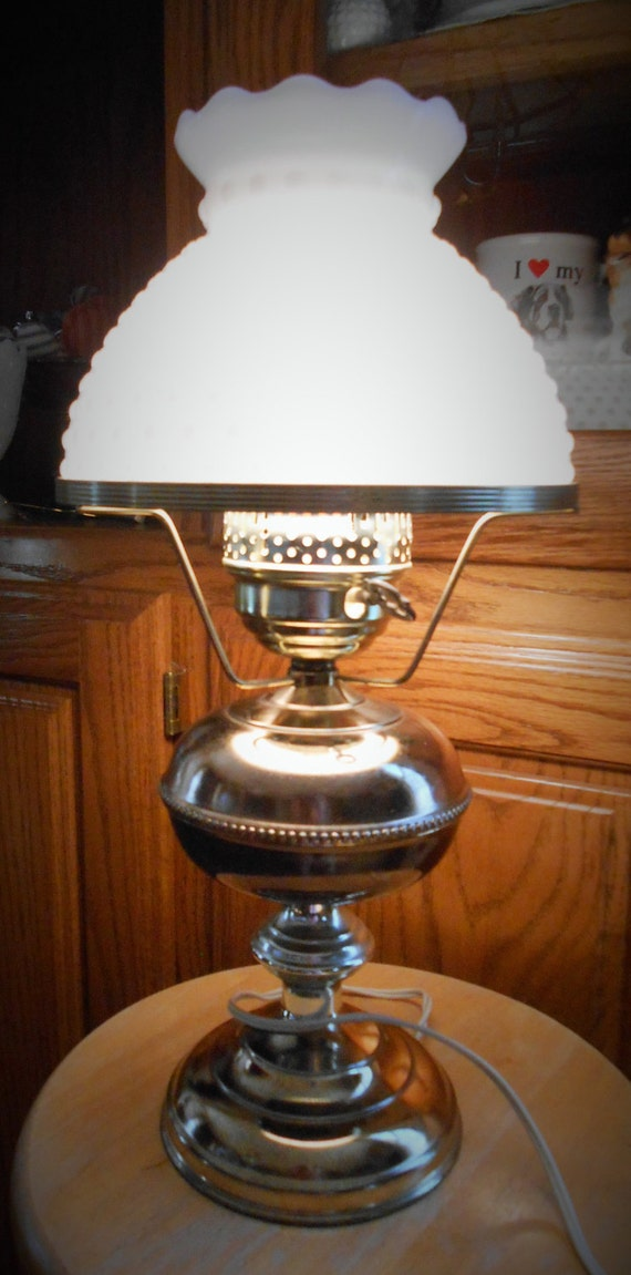 brass electric lamp with hobnail milk glass globe by