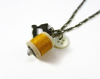 Yellow thread spool necklace brass - Old fashioned Singer machine charm necklace - Wooden spool pendant, mother of pearl button, seamstress