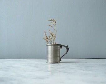 Vintage miniature stein. pewter tiny mug