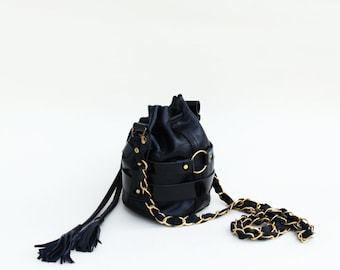 ODESSA - mini caged leather bucket bag - chain strap and tassels