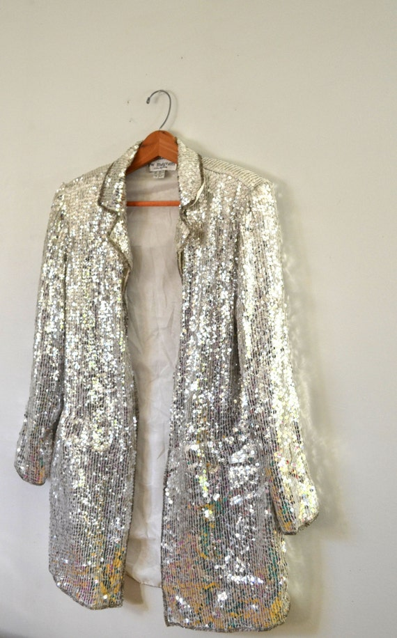 Dazzle and amaze wherever you go! When you decide to wear sequins, you had better go all out and this jacket will help you do just that! This silver sequin tailcoat jacket is perfect for magic shows, bands, hosting pep rallies, and even for funky weddings.