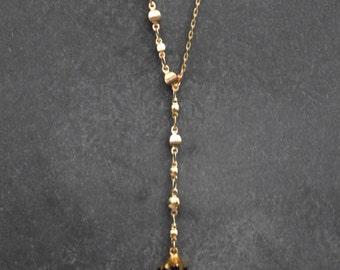 Gold tone, asymmetrical necklace.