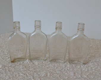Collection of 4 small flask shaped apothecary, pharmacy, drug bottles