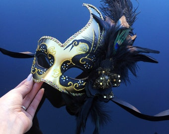 Womens Gold and Black Venetian Masquerade Mask with Feathers, Flowers, and Glitters Design