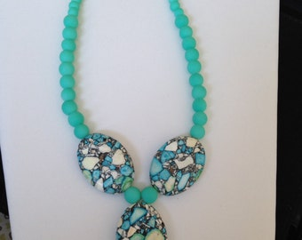 Turquoise stone and rubber bead necklace.