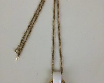 Trifari white & gold mod door knocker pendant on gold chain necklace