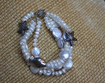 Freshwater Pearl Four Strand Bracelet.