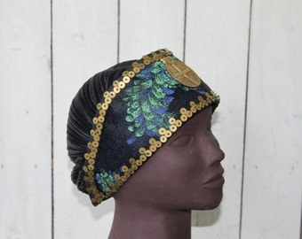 Hat adorned with a central medallion and embroidered with metal washers.It is unique and fully realized by hand;