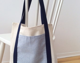 Handmade canvas tote with chambray linen front pocket.