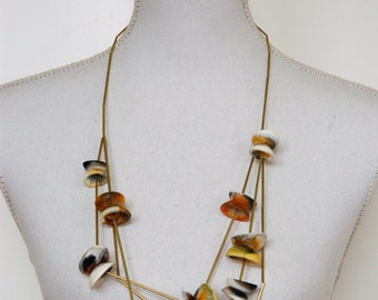 Pick-up-sticks necklace made of brass tubes and and resin elements
