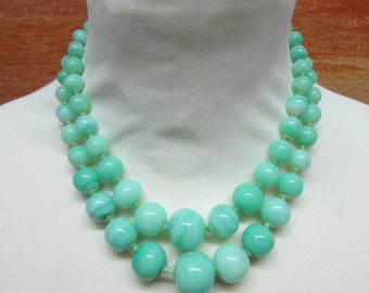 Mid-century double strand pale jade green glass bead necklace, carved clasp detail