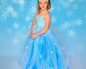 FROZEN Elsa tulle dress complete with a headband or bow.  Customized to reflect your child's personality.
