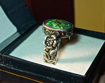 Genuine Australian Opal ring. Vine & Flower setting. All Hand crafted in Fine Silver. Real Opal ring.