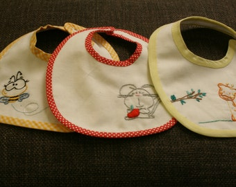 Embroidered baby bibs and handmade