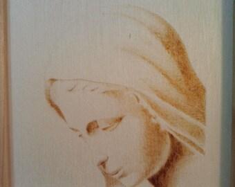 Madonna, pyrography on wood panel