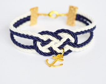 Navy blue and ivory cream double infinity knot nautical rope bracelet with gold anchor charm