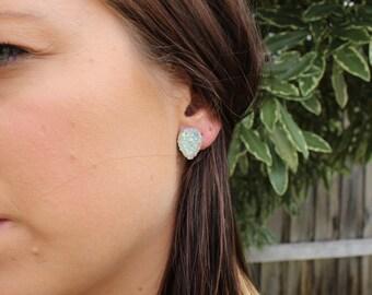 Silver teardrop post stud earrings.