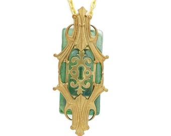 Steampunk Necklace Passages In Golden Brass with Escutcheon by Dr Brassy Steampunk Green Glass and Art Deco Gold Brass