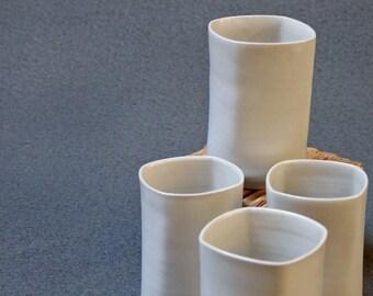 Set of four stoneware tumblers, hand thrown white stoneware, ceramics from Laurent Merchant