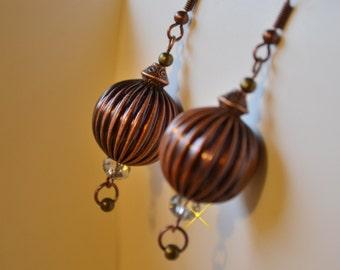 Hollow copper bead earrings.