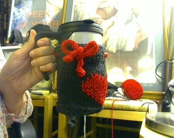 Knitted mug or cup cozy with heart