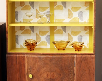 A stunning 1950's 'Spring' cabinet.