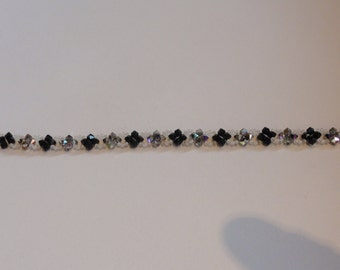 Bracelet of black, hard coal and rhinestone beads.
