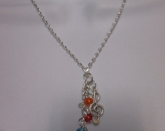 Music note G clef  & colorful crystals tassel necklace.