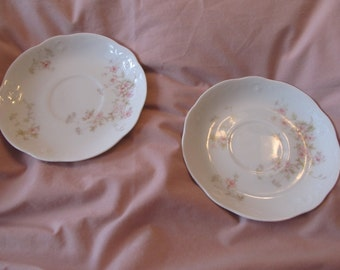 pair of O.P CO syracuse china saucers/ pale pink cherry blossom print/ 5 and 3/4 inches